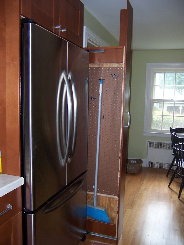 Adorable Single Sliding Broom Closet Design With Wooden Material And Simple  Hook Aside Refrigerator Beneath Wooden