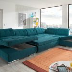 adorable turquoise tufted double chaise sectional design with modular storage seating before beige area rug and tosca floor lamp and large glass window upon white flooring idea