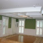 adorable white wall design with flashing green accent upon wooden floor with glass door and mounted ceiling design