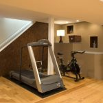affordable waterproofing basement floor with wooden laminating floor and gym room