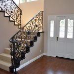 amazing bamboo floor idea with white concrete stair design with modern rod iron railing design and small windows