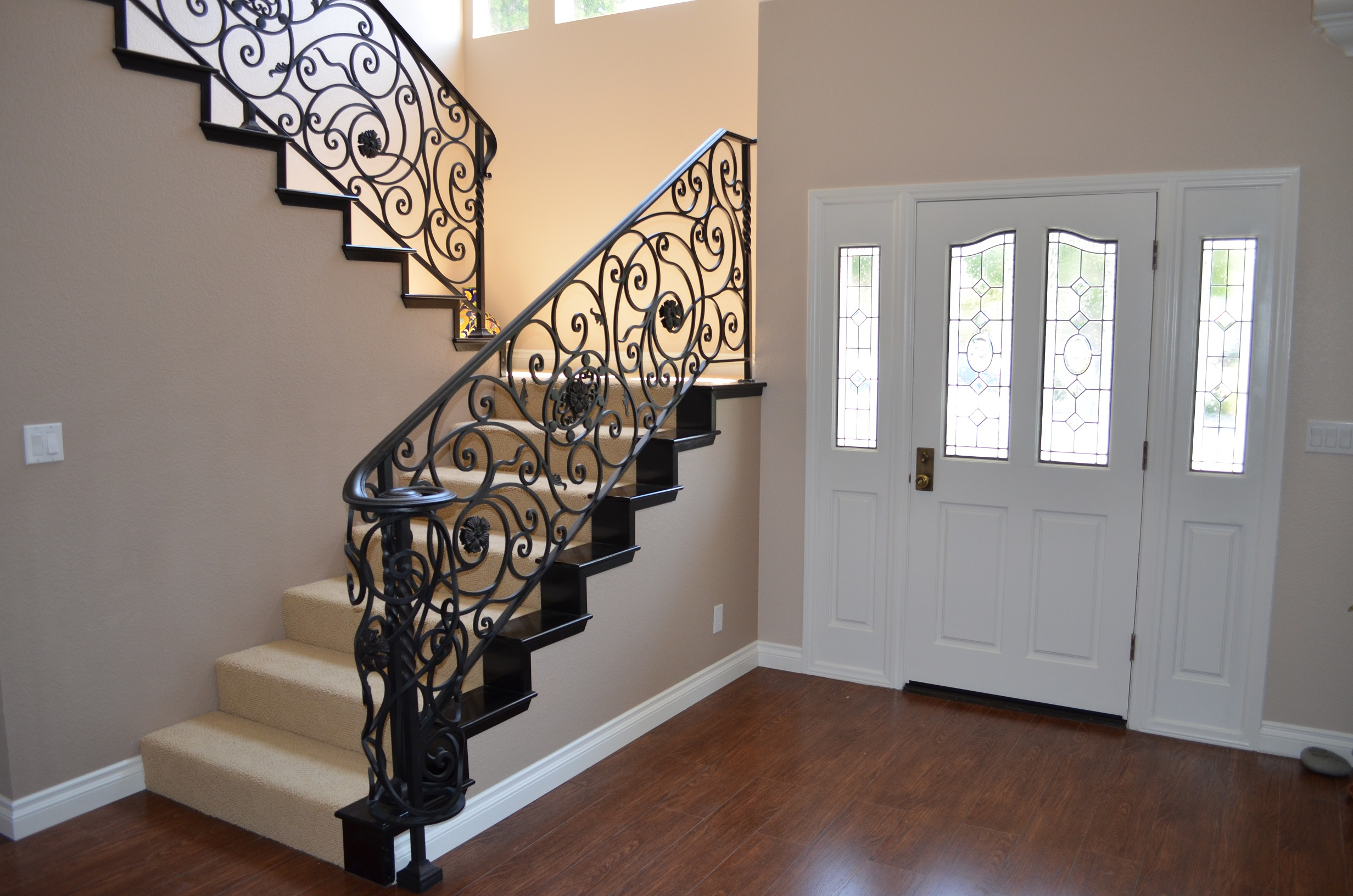 rod iron railing adds perfection to every step of. Black Bedroom Furniture Sets. Home Design Ideas