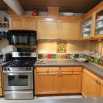 amazing beige mid century kitchen cabinetry with modern kitchen set and grey countertop and upper cabinet with kitchen tools hanger