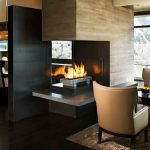 amazing bold two sided fireplace design with natural wooden like mantel and glossy white base aside dining table with open plan style