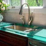 amazing green glass kitchen countertop for inexpensive need with modern faucet design in curve model aside pink flower decoration beneath glass window