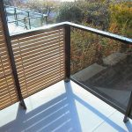 Amazing Modern Deck Railing Design In Horizontal Modern With Black Framed Glass Combination Upon White Concrete Floor Aside Greenery