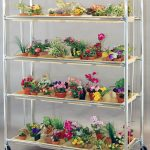 amazing modern metal cart for indoor plant shelves with four levels shelves with small pots for various flowers