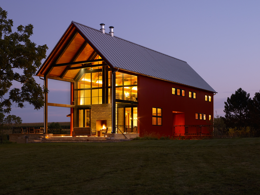 Amazing Pole Barn House Design With Tall Double Height Interior And Golden Lighting Reddish Wall