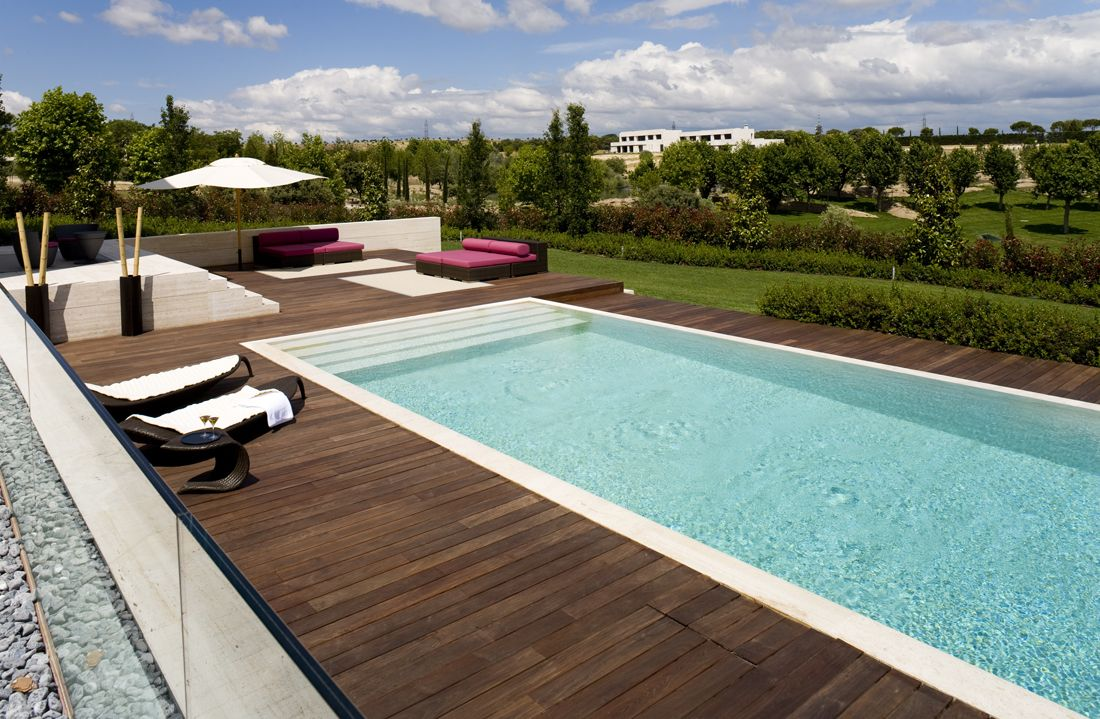 Rectangle pool designs that will give you awesome swimming for Landscaping ideas for pool areas
