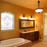 antique glass chandelier overlooking with cheerful orange wall paint color combined pretty stained window and rustic wooden powder rooms and sconces and bathtub bathroom remodel on budget