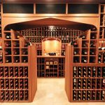 arch style wine cellar design with amazing arrangement with small slot and stunning inner table and multilevel range