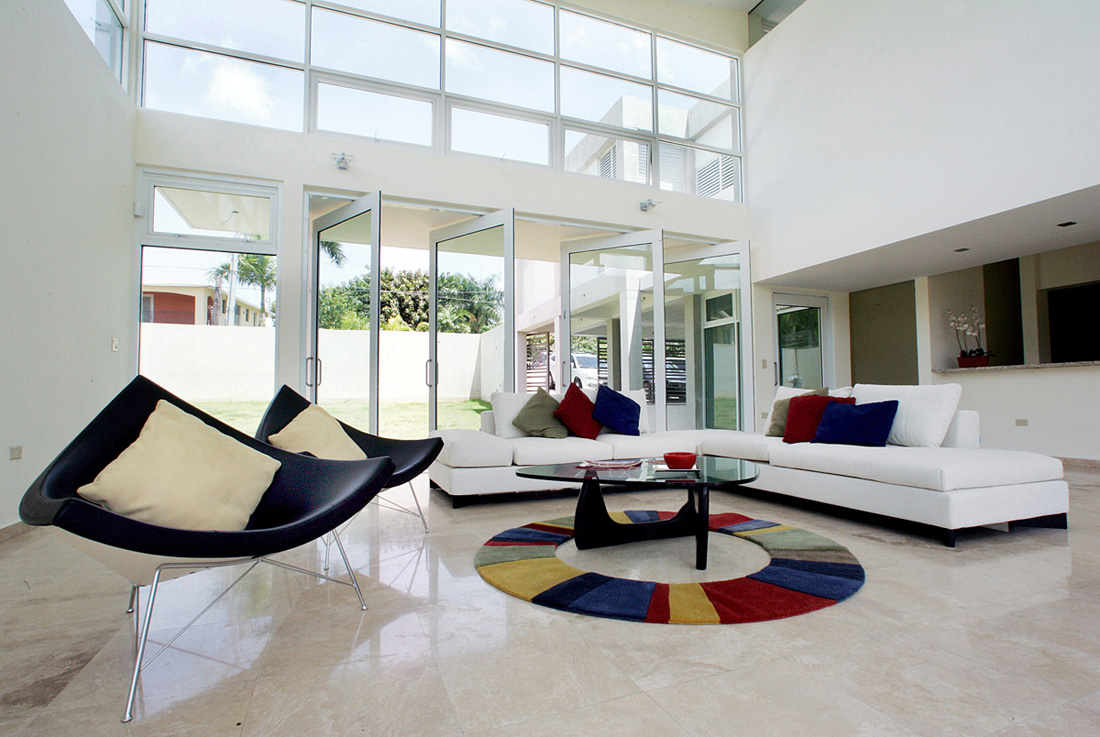 Architecture interior design for white living room with sectional sofa plus colorful cushions plus glass top