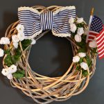 artistic rattan fourth of july wreath with sweet beautiful flower decoration and blue white ribbon and american flag
