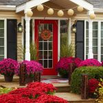 awesome bar red front door design with black glass accent and christmas decoration beneath cream wall with christmas ball and red purple flower combination