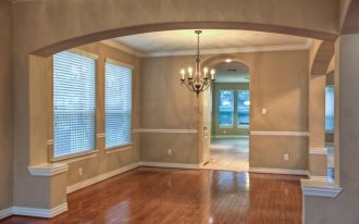 awesome gray and cream wall design with chair rail molding idea with arch door style and glass door and wooden floor