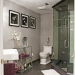 basement bathroom ideas with glass walk in shower and toilet plus sinks and storage and picture plus tile floor