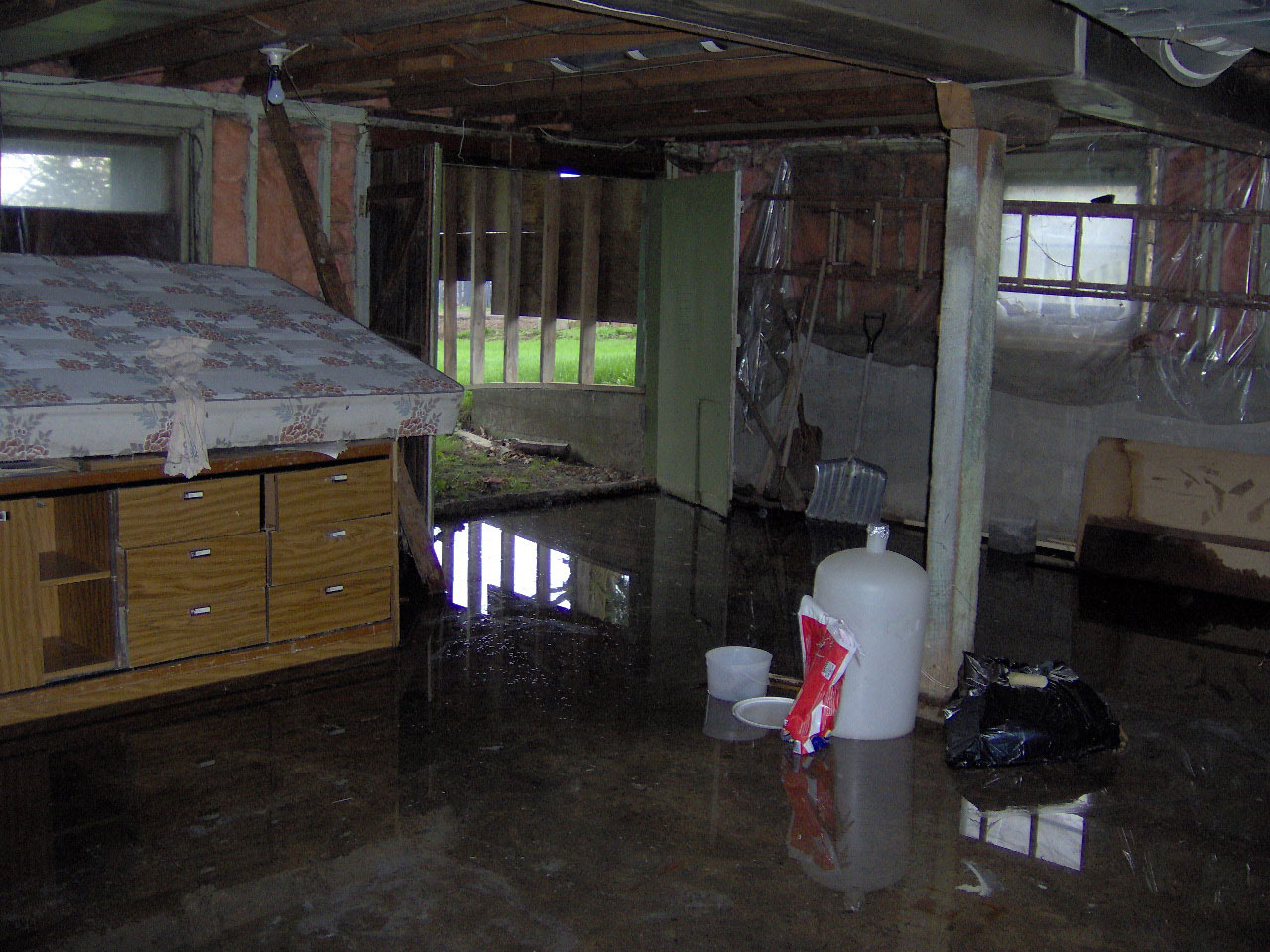 basement flooding solutions with drawer and bed
