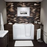bathroom remodelling in tiny space with bathtub and single vanity units plus mirror and brick wall plus pictures