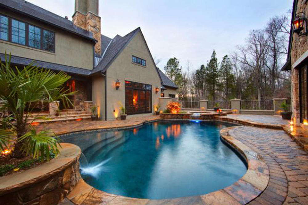 best backyard pools in curve shape with natural stone floor and small sauna plus mini fountain - Backyard Pool Design