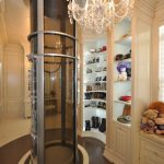 Best Custom Closets Nyc With Hard Wood Material In White Plus Mirror And Crystall Chandelier And Shoes Storage And Elevator