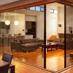Bifold La Cantina Door For Indoor Use A Set Of Grey Living Furniture A Set Of Modern Dining Furniture In Black  Wood Planks Floors