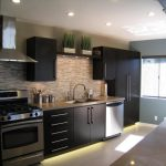 black cabinets for kitchen with metal handles  a set of modern kitchen appliances sink and faucet