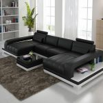 Black Double Chaise Sectional Chair  With Under Shelf Thick Brown Fury Carpet Minimalist Mini Credenza Behind The Chair A White Book Shelving System White Ceramic Floors