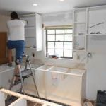 black frame window mixed with marshmallow wooden storage color from smart kitchen remodel contractors