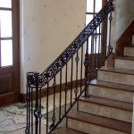 black iron railing in a stairway
