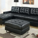 black leather modular sectional sofa for living room elegant and modern carpet artistical painting as wall decoration black standing lamp with tiny metal stand