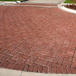 brick paver patterns with running bond pattern  in garden with one color paver brick and circle edging