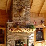 bricks fireplace building with driftwood mantle as the base of shelf unit a mounted TV cabinet with storage  glass door book rack high ceiling construction made from wood