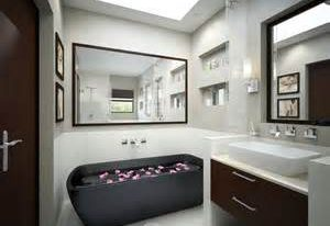 bright large skylight overlooking with enthralling bathroom remodeling contractors feature with romantic black hot tub and twin framed mirrors