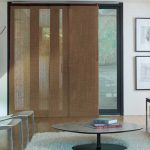 brown honeycomb window shades for sliding glass door white carpet round glass table wood flooring