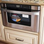 built in microwave drawer in bottom kitchen cabinet