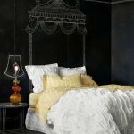 chalkboard wall as well as the bed headboard  black bedside table with unique table lighting fixture red carpet black ceramic floor