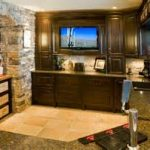 classic basement wet bar ideas decorated with stone arch way and excellent wooden furniture sets and extensive wall tv
