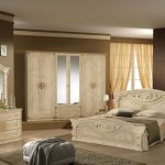 classy beige bedroom ideas with luxury bed and wooden night stand plus make up table with mirror and closet plus rug and grey stool plus table lamps and pictures