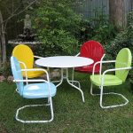 colorful lawn chair idea with round backrest and rectangle seating with metal frame before round white table design upon grassy meadow beneath shady tree