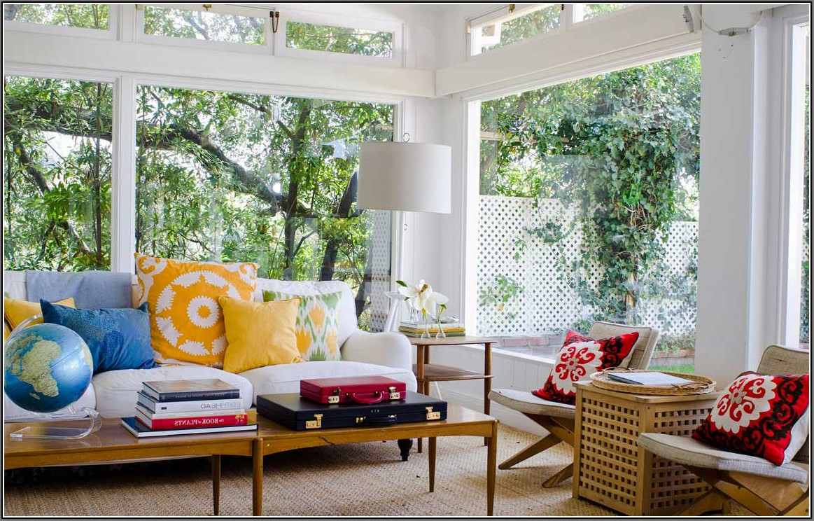 Colorful Sun Porch Design With Open Plan And Glas Wall And Ceiling With  Rattan Seating And