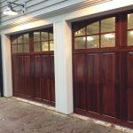 contemporary dalton two car garage door with hard wood plus windows on top and beautiful wall scones