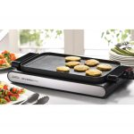 contemporary electric home hibachi grill with slim and flexible mdel in black white colors aside table ware
