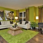 Cool Fresh Nice Modern Exotic Living Room In Green Brown Earth Tone And Wooden Furniture With Wooden Original Flooring Design