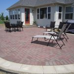 cool herringbone brick paver patterns in patio with two colors brick combined with stack bond pattern and lounge chairs and table
