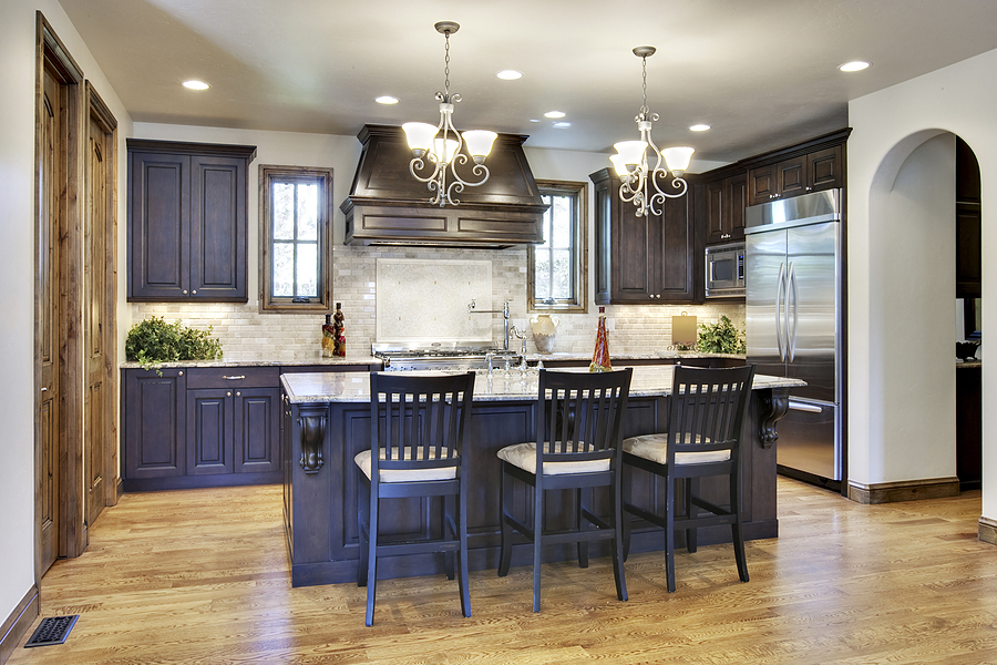 Cool Kitchen Remodeling With Dark Wood Cabinets And Marble Countertop Plus Island Sink Microwave