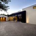 cool wooden garage doors with material plus lighting combined with beautiful house design
