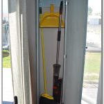corner closet for organizing brooms and other cleaning tools