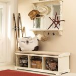 corner entrance point bench with under shelves floating hanger unit  several metal wire basket as the storage red basket rug for entryway