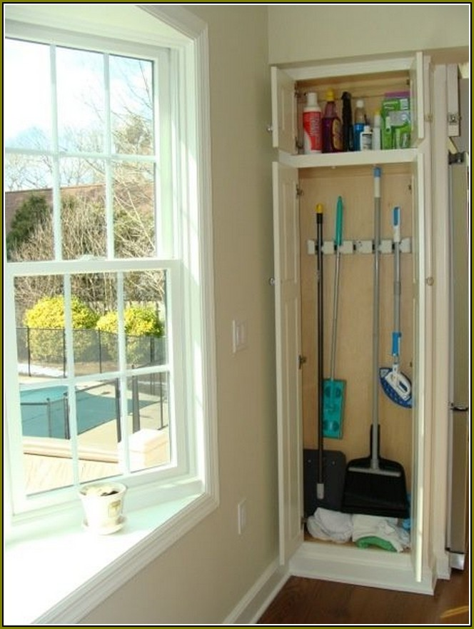 Corner Vertical Broom Closet With A Shelf For Storing Home Cleanser