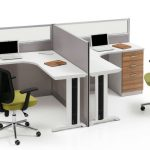corner workstation for two people with divider and filing drawers a table lamp two units of laptops and movable office chairs
